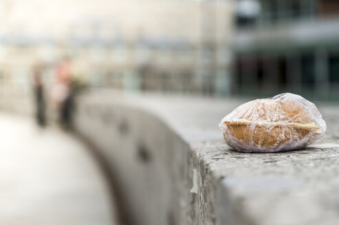Bread roll wrapped in foil on wall - FRF00537