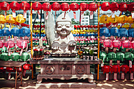 South Korea, Seoul, Happy Buddha statue surrounded by colorful lanterns at Jogyesa Temple - GEMF01757