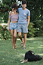Couple in love with dog walking in a park - ALBF00150
