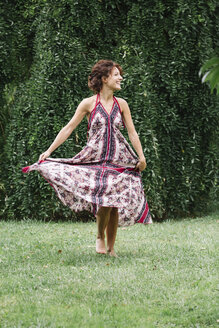 Happy woman in a park wearing summer dress - ALBF00183