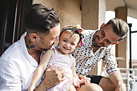 Happy gay couple with daughter at home - MRAF00225