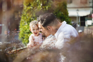 Happy gay couple with their daughter outdoors - MRAF00234