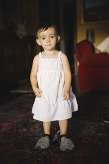 Portrait of baby girl wearing oversized shoes at home - MRAF00249