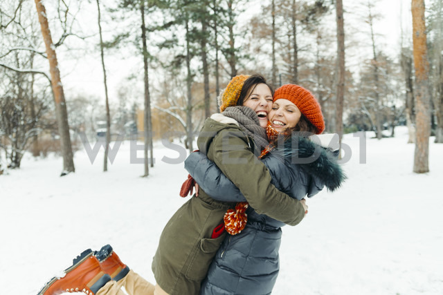 Two best friends having fun in the snow - ZEDF00808