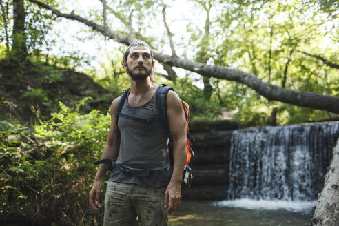 Young man on a hiking trip at a waterfall - VPIF00027