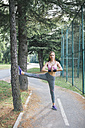 Young woman exercising in park - MOMF00223