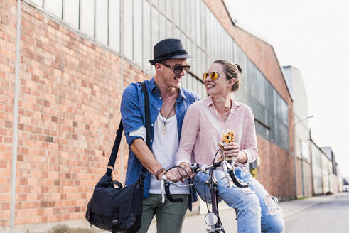 Young couple with bicycle on the street - UUF11519