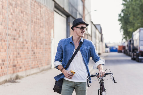 Young man with bicycle on the street - UUF11522