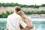 Affectionate young couple at lakeshore - ABIF00005