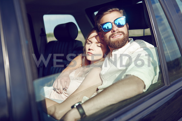 Affectionate young couple relaxing in car - ABIF00014