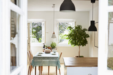 Bright modern kitchen and dining room in an old country house - PDF01265