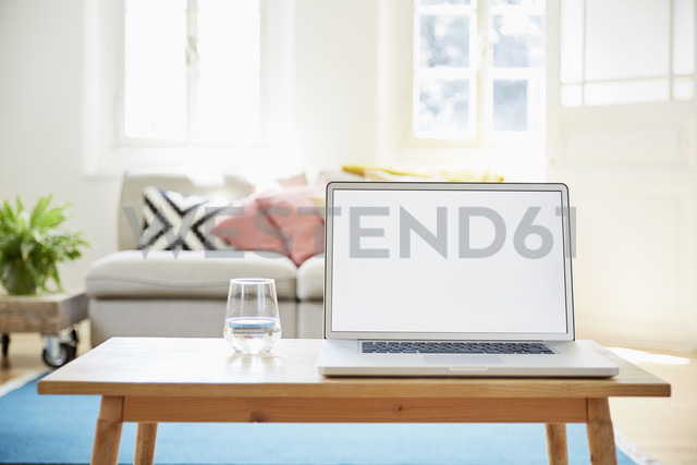 Laptop on coffee table in a modern living room of an old country house - PDF01271 - Philipp Dimitri/Westend61