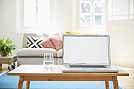 Laptop on coffee table in a modern living room of an old country house - PDF01271