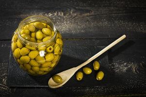 Preserving jar of pickled green olives - MAEF12398