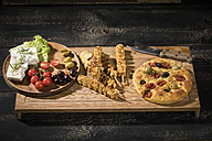 Meat skewers, flat bread, sheep cheese, tomatoes and olives on wooden board - MAEF12410