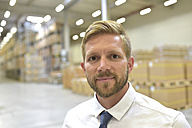 Portrait of confident businessman in warehouse - LYF00769