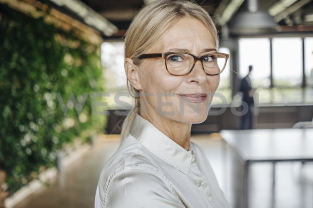 Portrait of confident businesswoman in office - JOSF01398