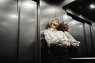 Exhausted businesswoman in elevator - JOSF01434