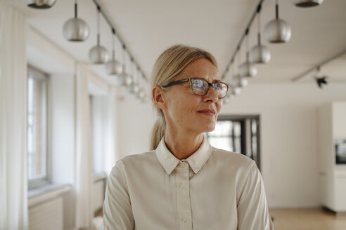Portrait of smiling businesswoman in office - JOSF01518