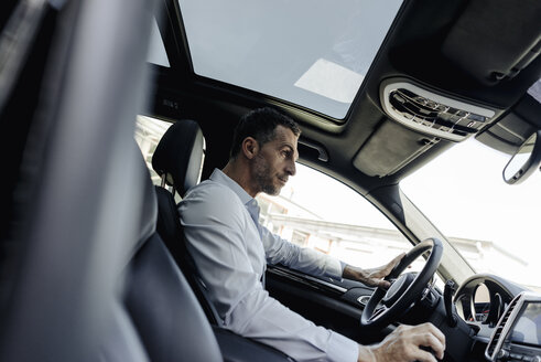Businessman driving car - KNSF02464