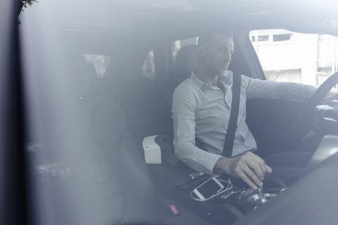 Businessman driving car - KNSF02467