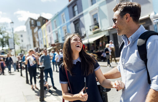 UK, London, Portobello Road, couple having fun - MGOF03579