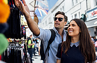 UK, London, Portobello Road, couple on a shopping spree - MGOF03585