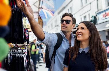 UK, London, Portobello Road, couple on a shopping spree - MGOF03585
