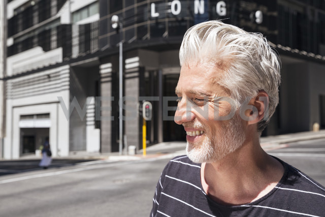 Portrait of a mature man, walking in the city - WESTF23505