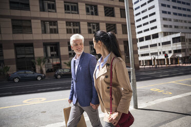 Mature couple walking in the city - WESTF23529