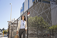 Businesswoman walking in the city - WESTF23538