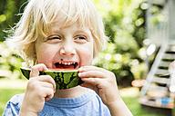 Portrait of little boy eating slice of watermelon - SPFF00041