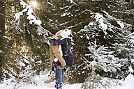 Happy young couple face to face in  snow-covered winter forest - HAPF02024