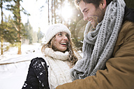 Happy young couple face to face in  winter - HAPF02030