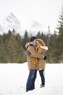 Young couple in love in winter landscape - HAPF02039