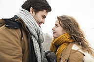 Young couple in love face to face in winter - HAPF02060