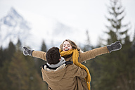 Happy young couple having fun in winter forest - HAPF02096