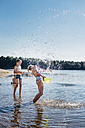 Children splashing with water at lakeshore - MJF02175