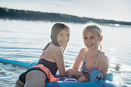 Portrait of two girls with swim toy at lake - MJF02187