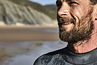 Portugal, Algarve, portrait of confident surfer on the beach - JRF00325