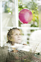 Portrait of girl with balloon behing window - MOEF00138