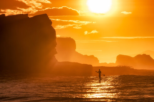 UK, Scotland, East Lothian, Paddle Board Surfing at sunset - SMAF00818