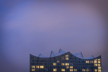 Germany, Hamburg, lighted Elbe Philharmonic Hall at evening twilight - KEBF00614