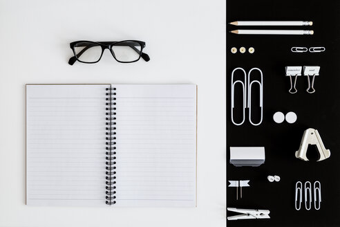 White office utensils on black background and notepad and glasses on whilte background - MELF00187