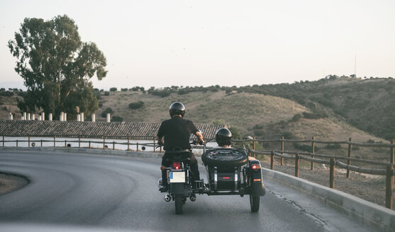 Spain, Jaen, mature couple riding on motorcycle with a sidecar - JASF01815