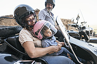 Spain, Jaen, grandfather, grandmother and grandson on motorcycle with a sidecar - JASF01824