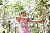 Girl shooting with bow and arrow in the forest - MFRF00975