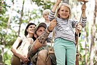 Happy family in forest with girl on swing - MFRF00990