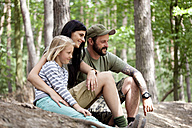Happy family with daughter in forest - MFRF00993