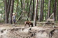 Boy walking with dog in forest - MFRF01002